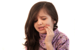 little girl with toothache