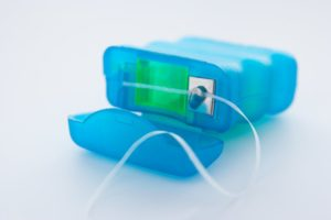 blue floss container lying open