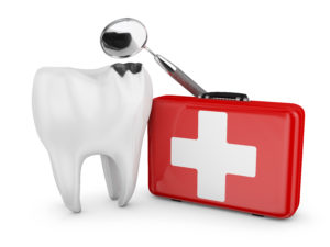 white tooth beside red emergency kit